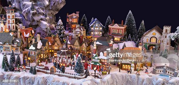 decorative christmas village with charles dickens theme - ebenezer scrooge stock photos and pictures