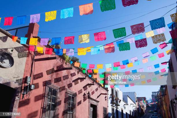 decorative colourful paper flags - mexican fiesta stock pictures, royalty-free photos & images