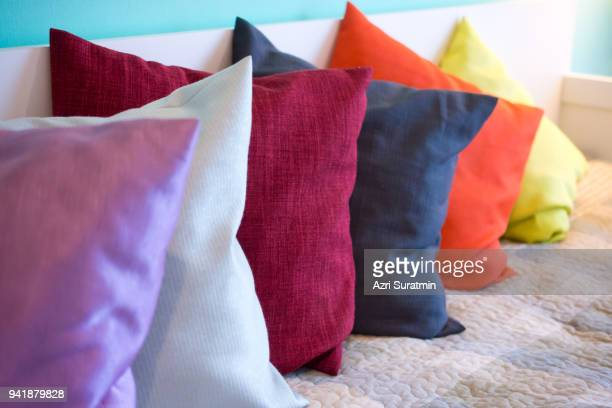 decorative comfortable pillow natural fabric, with multi-colored pillows - cushion stock photos and pictures