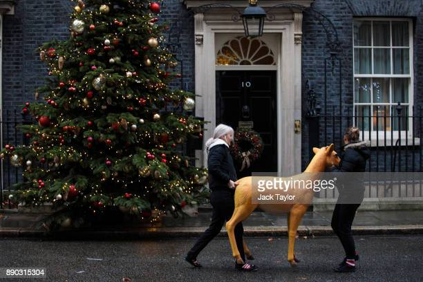 A decorative deer model is carried past Number 10 Downing Street on December 11 2017 in London England British Prime Minister Theresa May is to...