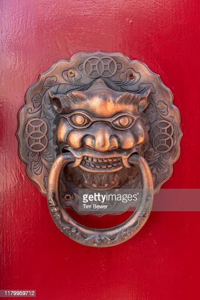 decorative door handle. - tim bewer stock pictures, royalty-free photos & images