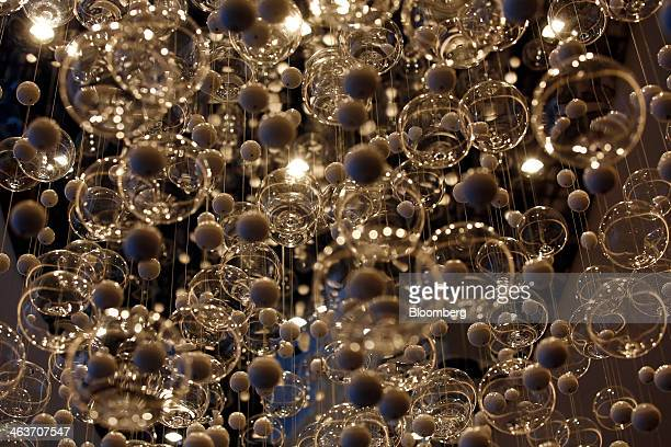 Decorative glass baubles hang from the ceiling inside the InterContinental hotel Davos operated by InterContinental Hotels Group Plc in Davos...