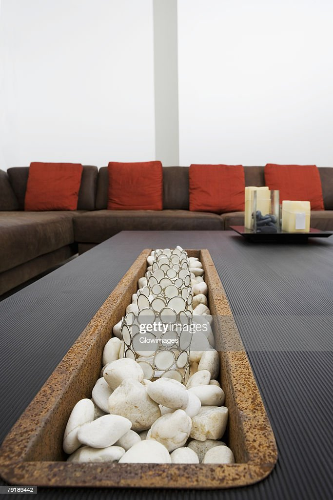 Decorative glasses and pebbles on a coffee table : Stock Photo