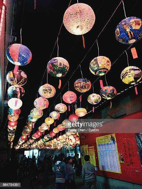 Decorative Lanterns Hanging On Street At Night