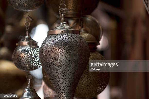 decorative lanterns or lamps for sale at a shop in the medina of marrakesh. marrakesh, marrakesh-safi, morocco. - souk stock pictures, royalty-free photos & images