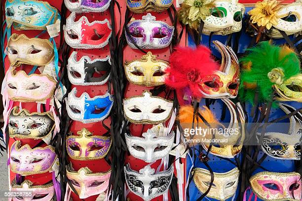 decorative mask display, venice - venice carnival stock pictures, royalty-free photos & images