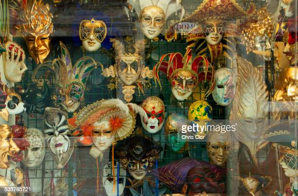 Decorative masks hanging in store window