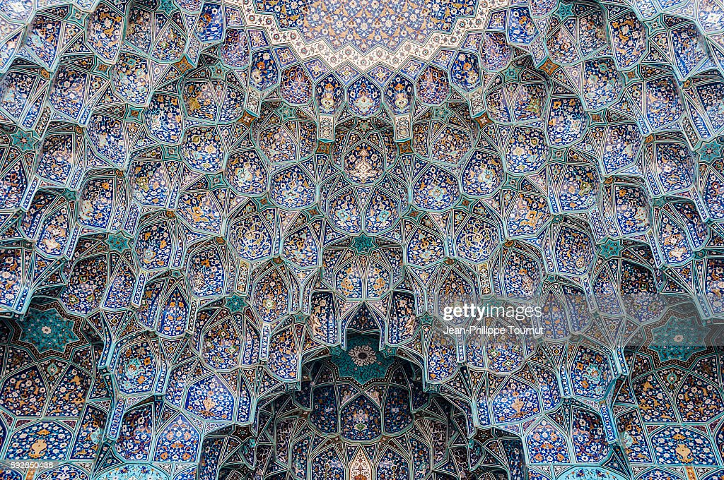 Ceramic tiles painted on the entrance portal of the Shah Mosque in Iran