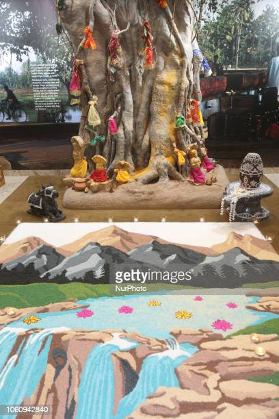 Decorative rangoli design made with colored rice depicting Mount Kailash at a Hindu temple during Diwali in Toronto Ontario Canada