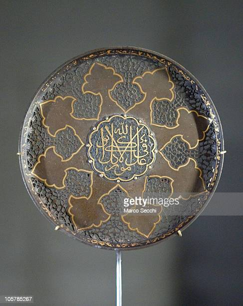 Decorative steel roundel with gold overlay from Iran XVII Century the central insciption reading My reliance is on God in all matters at the opening...
