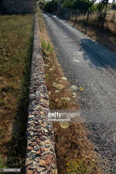 decorative stone wall along the road in ovacik. - emreturanphoto stock pictures, royalty-free photos & images