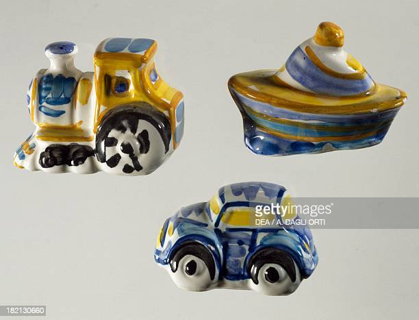 Decorative sweet boxes for christening and first communion in the shape of locomotive car and boat ceramic Caltagirone manufacture Sicily Italy 20th...