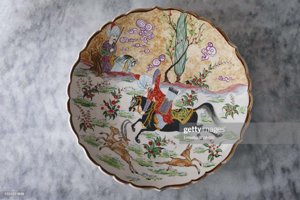 Decorative Turkish ceramic wall plate on gray tabletop. : Stock Photo