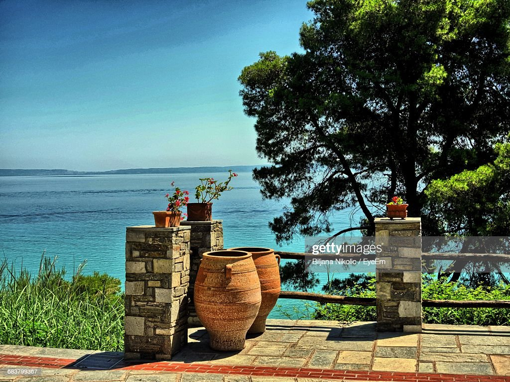Decorative Urns By Potted Plants Against Sky Stock Photo Getty Images