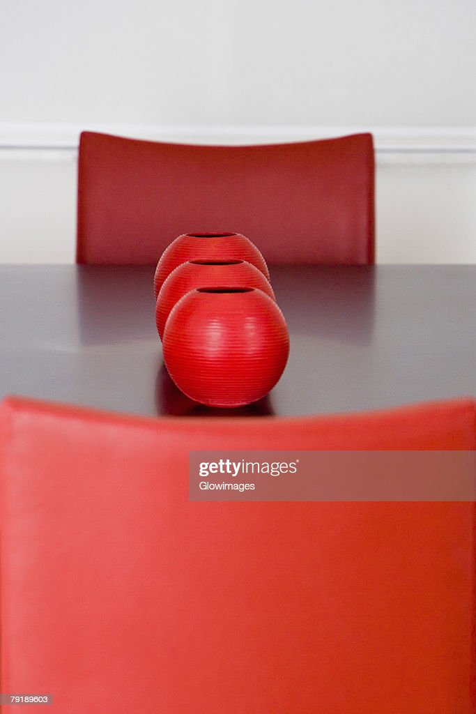 Decorative urns on a dining table in a dining room : Stock Photo