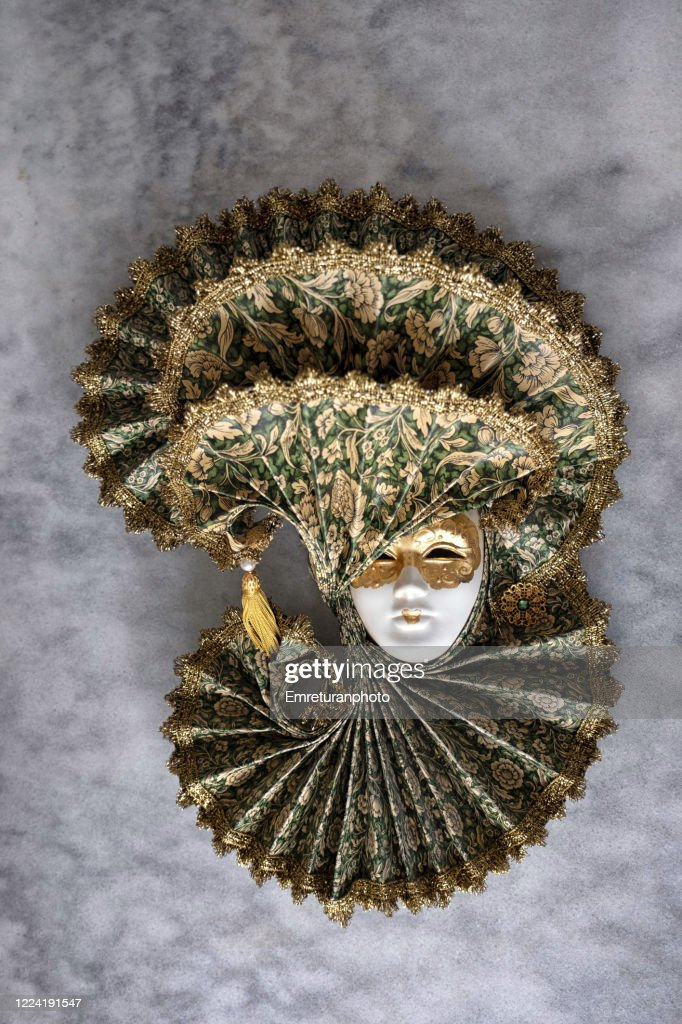 Decorative Venetian mask on gray tableto. : Stock Photo