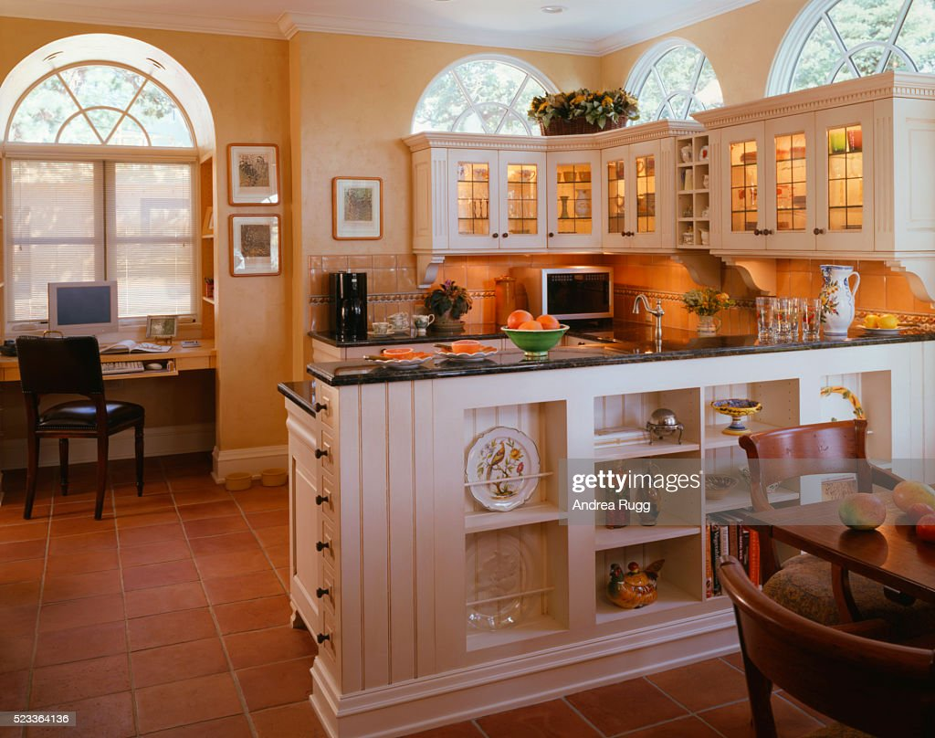 home office nook. Decorative White And Yellow Kitchen With Home Office Nook : Stock Photo T
