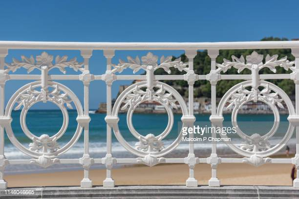 decorative wrought iron railing on the promenade, la concha beach, san sebastian, basque country, spain - san sebastian spain stock pictures, royalty-free photos & images