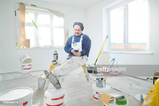 decorator online banking - bib overalls stock pictures, royalty-free photos & images