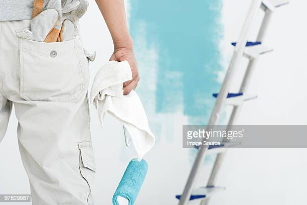 Decorator with paint roller and cloth