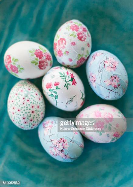 Decoupage easter eggs on big turquoise plate