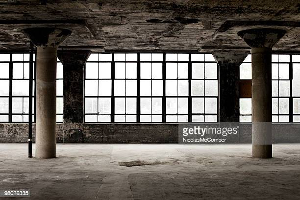 Decrepit industrial loft with columns and windows
