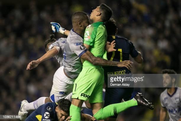 Dedé of Cruzeiro collides with Esteban Andrada of Boca Juniors during a Quarter Final first leg match between Boca Juniors and Cruziro at Alberto J...