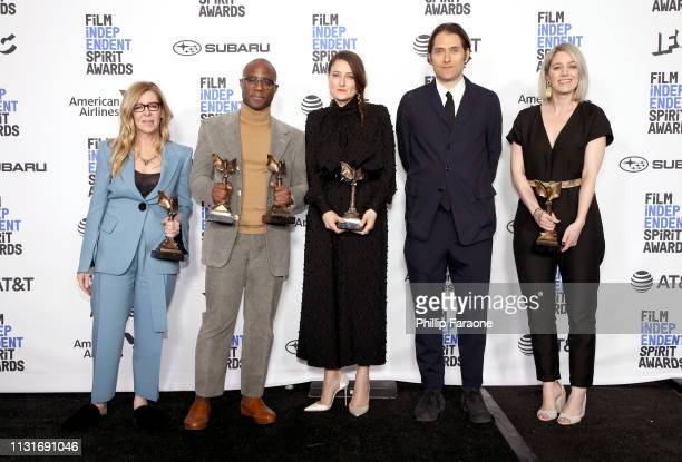 "Dede Gardner Barry Jenkins Adele Romanski Jeremy Kleiner and Sara Murphy pose in the press room with the Best Feature award for the film ""If Beale..."