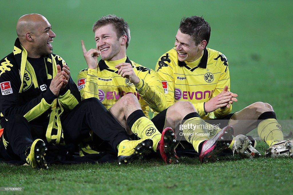 Dede, Jakub Blaszczykowski and Lukasz Piszczek of Dortmund celebrate the 2-0 victory after the Bundesliga match between Borussia Dortmund and Werder Bremen at the Signal Iduna Park on December 11, 2010 in Dortmund, Germany.