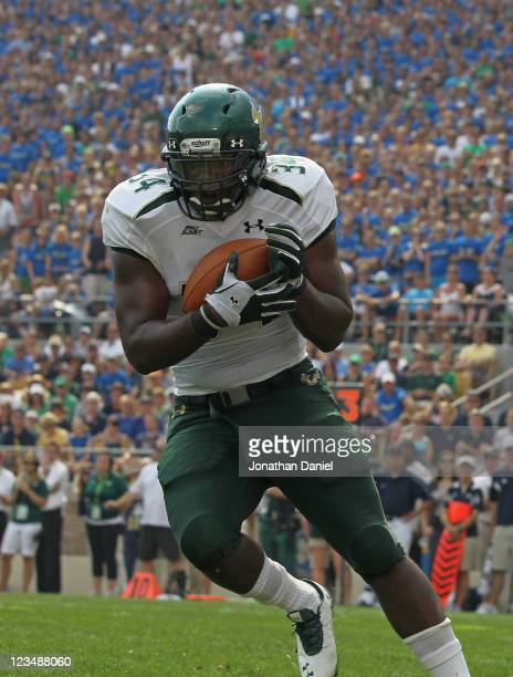 DeDe Lattimore of the University of South Florida Bulls intercepts a pass in the end zone against the Notre Dame Fighting Irish at Notre Dame Stadium...