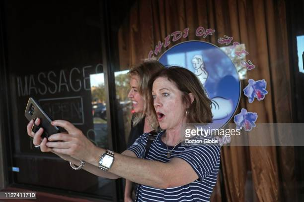 Dede Laux left and Patty Conway stop to take a selfie outside Orchids of Asia Day Spa in Jupiter FL where New England Patriots owner Robert Kraft is...