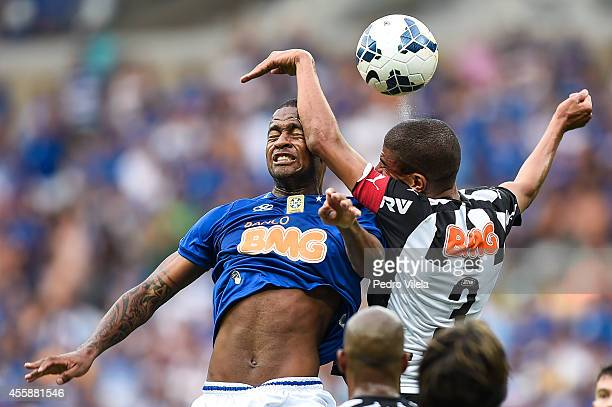 Dede of Cruzeiro and Leonardo Silva of Atletico MG battle for the ball during a match between Cruzeiro and Atletico MG as part of Brasileirao Series...