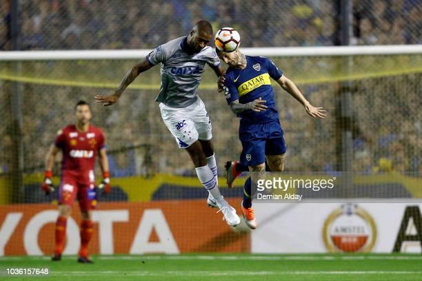 Dede of Cruzeiro goes for a header against Dario Benedetto of Boca Juniors during a Quarter Final first leg match between Boca Juniors and Cruzeiro...