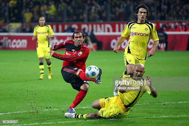 Dede of Dormtund blocks a shot of Theofanis Gekas of Leverkusen during the Bundesliga match between Bayer Leverkusen and Borussia Dortmund at the...