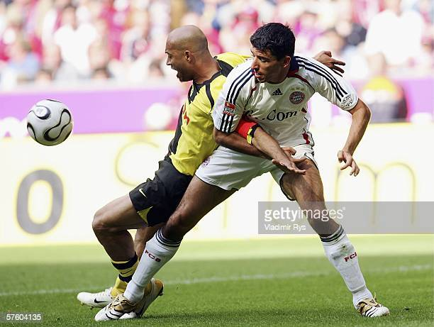 Dede of Dortmund and Roy Makaay of Bayern battle for the ball during the Bundesliga match between FC Bayern Munich and Borussia Dortmund at the...