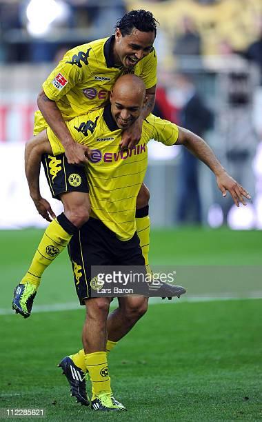 Dede of Dortmund celebrates with team mate Antonio da Silva after winning the Bundesliga match between Borussia Dortmund and SC Freiburg at Signal...