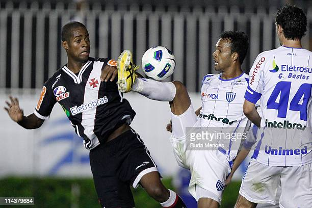 Dede of Vasco struggles for the ball with a players of Avai during a match as part of Brazil Cup 2011 at Sao Januario stadium on May 18 2011 in Rio...