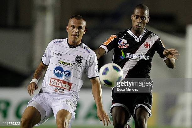 Dede of Vasco struggles for the ball with Crecildo of ABC during a match as part of Brazil Cup 2011 at Sao Januario stadium on April 06, 2011 in Rio...