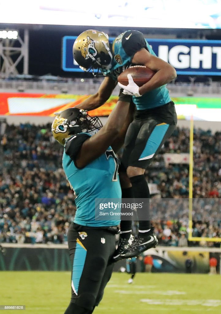 Dede Westbrook #12 and Cam Robinson #74 of the Jacksonville Jaguars celebrate after Westbrook scored an 18-yard touchdown against the Seattle Seahawks during the second half of their game at EverBank Field on December 10, 2017 in Jacksonville, Florida.