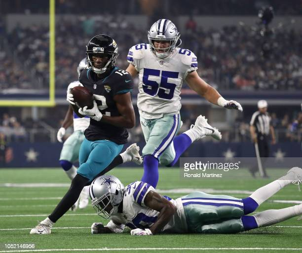 Dede Westbrook of the Jacksonville Jaguars carries the ball on a touchdown run against Leighton Vander Esch and Anthony Brown of the Dallas Cowboys...