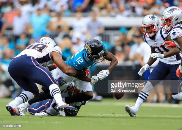 Dede Westbrook of the Jacksonville Jaguars fumbles the ball in the first half against the New England Patriots at TIAA Bank Field on September 16...
