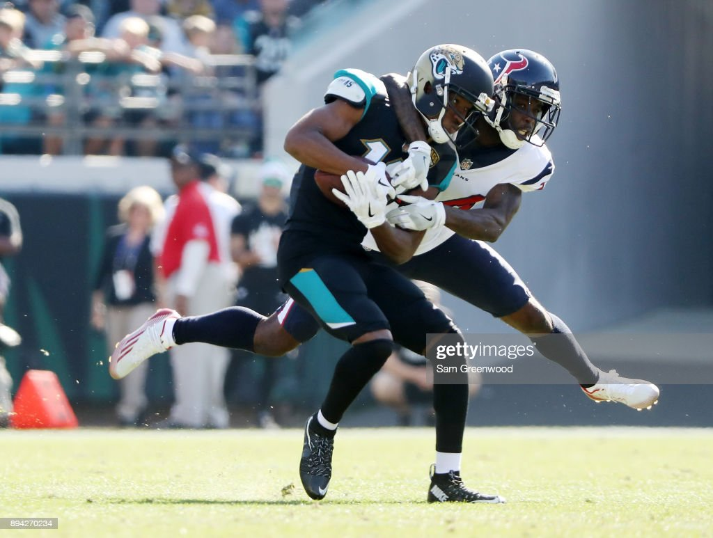 Dede Westbrook #12 of the Jacksonville Jaguars is tackled by Johnathan Joseph #24 of the Houston Texans in the first half of their game at EverBank Field on December 17, 2017 in Jacksonville, Florida.