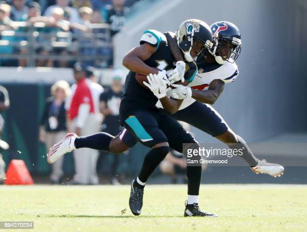 Dede Westbrook of the Jacksonville Jaguars is tackled by Johnathan Joseph of the Houston Texans in the first half of their game at EverBank Field on...