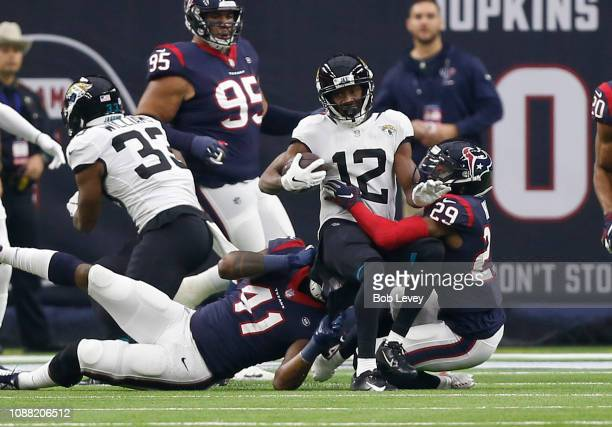 Dede Westbrook of the Jacksonville Jaguars is tackled by Zach Cunningham of the Houston Texans and Andre Hal attempting to score during the first...