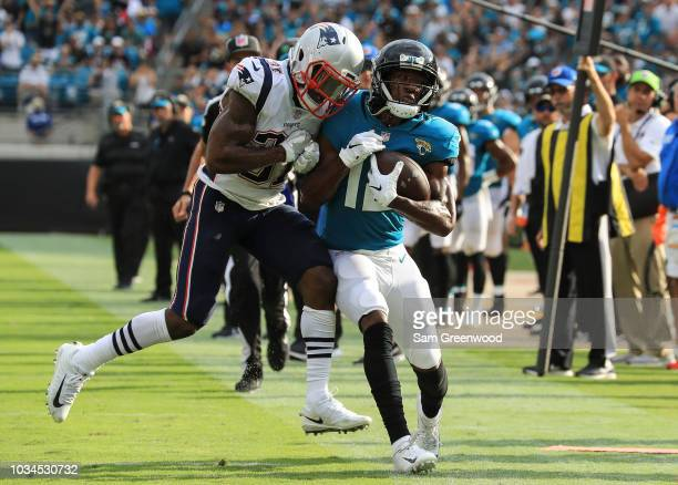 Dede Westbrook of the Jacksonville Jaguars is tackled out of bounds by Jonathan Jones of the New England Patriots during the first half at TIAA Bank...