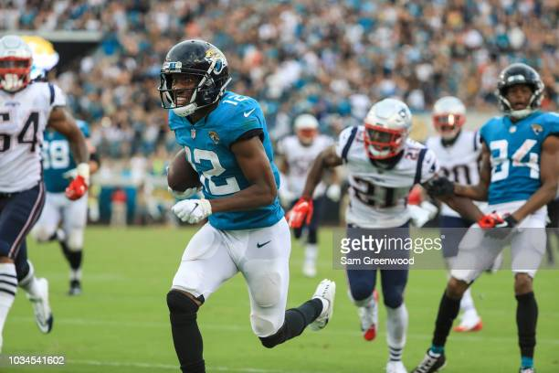 Dede Westbrook of the Jacksonville Jaguars runs for a 61yard touchdown reception during the second half against the New England Patriots at TIAA Bank...