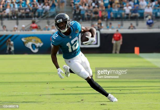 Dede Westbrook of the Jacksonville Jaguars runs for yardage during the game against the New England Patriots at TIAA Bank Field on September 16 2018...