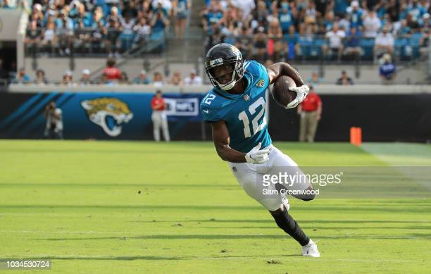 Dede Westbrook of the Jacksonville Jaguars runs with the ball during the first half against the New England Patriots at TIAA Bank Field on September...