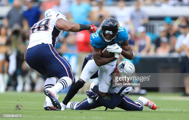 Dede Westbrook of the Jacksonville Jaguars rushes for yardage during the game against the New England Patriots at TIAA Bank Field on September 16...
