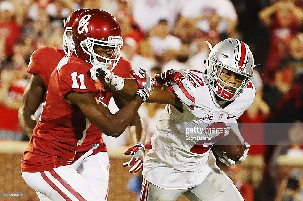 Dede Westbrook #11 of the Oklahoma Sooners tackles Marshon Lattimore #2 of the Ohio State Buckeyes as he ran an interception back in the first half of their game at Gaylord Family Oklahoma Memorial Stadium on September 17, 2016 in Norman, Oklahoma.